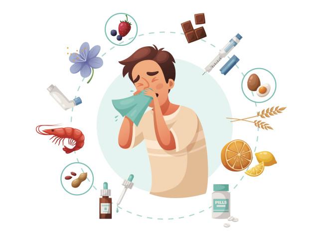 Rodzaje alergii - chłopiec kichający w otoczeniu alergenów